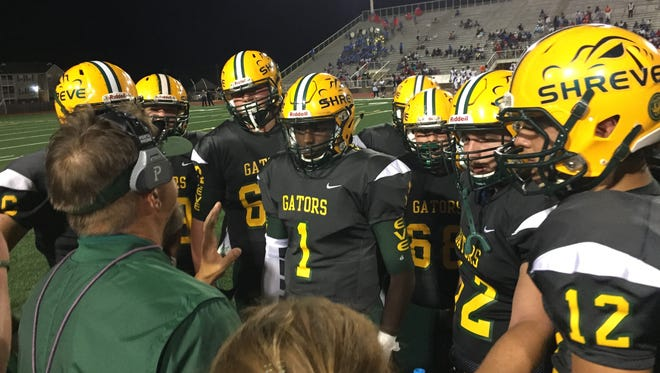 The Captain Shreve offense gets final instructions late against Woodlawn in the Gators' 19-18 victory.