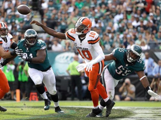 FILE - In this Sept. 11, 2016, file photo, Cleveland Browns' Robert Griffin III (10) passes against Philadelphia Eagles' Brandon Graham (55) during the second half of an NFL football game, in Philadelphia. Griffin III has been cleared for contact, paving the way for him to play again this season. Griffin has been sidelined since breaking a bone in his left shoulder late in the Sept. 11 opener against Philadelphia.(AP Photo/Matt Rourke)