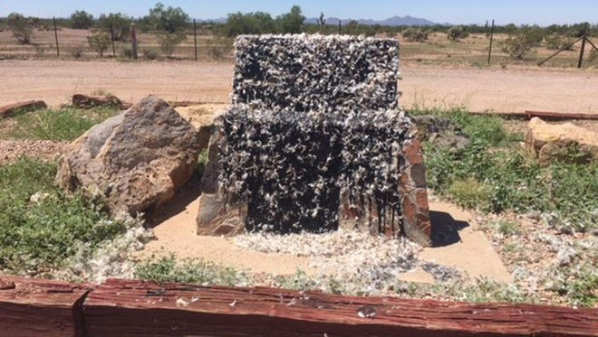 The Jefferson Davis Highway monument outside Apache Junction, Ariz., was tarred and feathered, as seen Thursday, Aug. 17, 2017. The monument is one of six Confederacy monuments in Arizona.