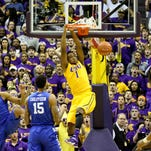 LSU Tigers forward Jarell Martin (1) dunks over Kentucky Wildcats forward Willie Cauley-Stein (15) and forward Karl-Anthony Towns (12) during the first half of their game earlier this season. Martin has opted to leave LSU early for the NBA.