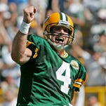 Former Green Bay quarterback Brett Favre reacts after throwing a touchdown pass during a game in 2007.