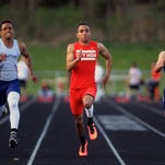 City High's Bryson Runge competes in the 100 meter dash during the Forwald/Coleman Relays at City High on Thursday, April 16, 2015. David Scrivner / Iowa City Press-Citizen