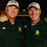 Northwestern State coach Jay Thomas, left, and Demons defensive coordinator Daryl Daye mug during their coaching days at Missouri Southern.