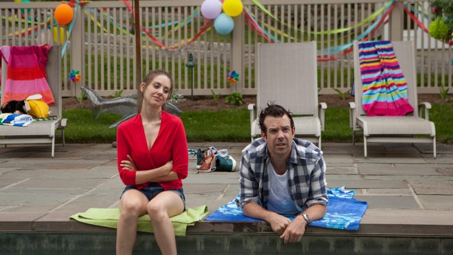 "Alison Brie, left, and Jason Sudeikis appear in a scene from ""Sleeping with Other People."""
