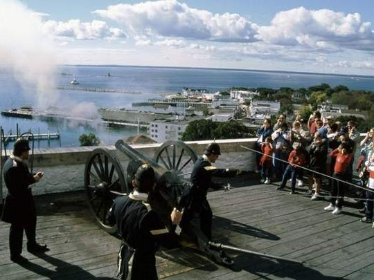This photo from Mackinac State Historic Parks shows cannon firing demonstrations by costumed interpreters at Fort Mackinac on Mackinac Island on Lake Huron, an important site in the War of 1812.