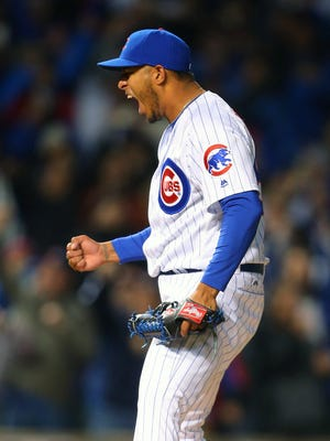 Hector Rondon celebrates the final out of the ninth inning against the Reds at Wrigley Field on April 11.