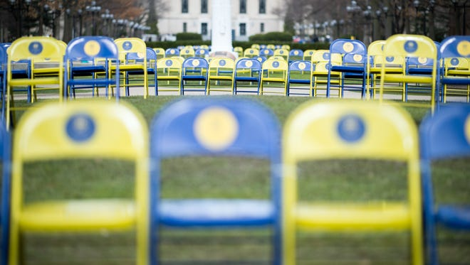 """As part of the """"Stumbling Blocks,"""" exhibit to recognize some of the controversies in the University of Michigan's past, 1300 chairs were set out in the Diag to represent the 1,300 African American, Latino and Native American students who were not enrolled in 2006 as a result of prop 2."""