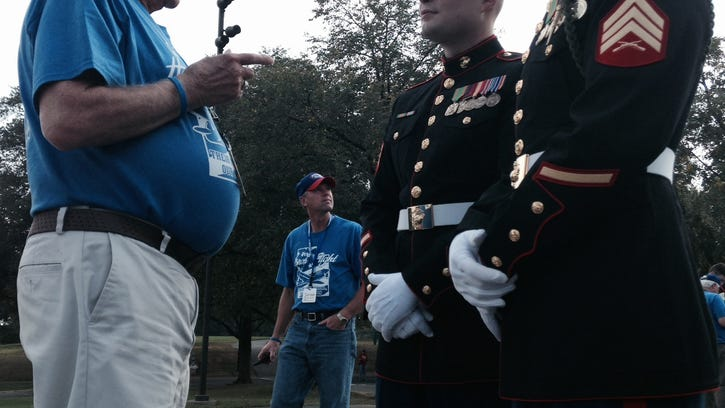 """WWII Marine Ellis """"Carl"""" Cook, of St. George, speaks with his nephew Robert Sandoval, right, who is also a Marine, at the Iwo Jima Memorial on Wednesday."""