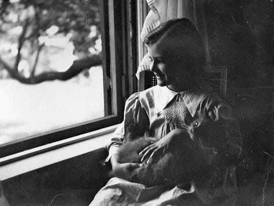 Janet Livingston is shown holding Topaz the cat in