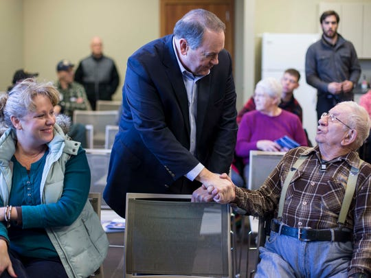 Republican presidential candidate Mike Huckabee greets audience members as he campaigns Tuesday Jan. 12, at the Williamsburg Public Library.