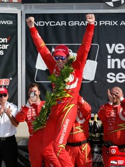 Scott Dixon celebrates his win at Watkins Glen International.