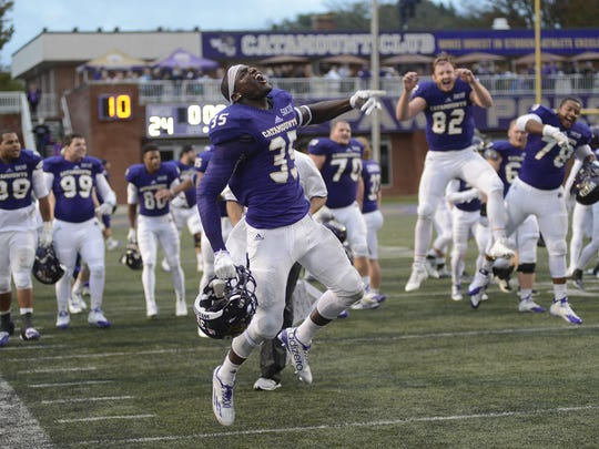 Keion Crossen leads the Western Carolina celebration after defeating Mercer on Saturday.