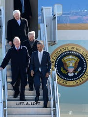 President Barack Obama, followed by Sen. Lamar Alexander, R-Tenn., Sen. Bob Corker, R-Tenn., and Rep. John Duncan Jr., R-Tenn., leave Air Force One after arriving in Tennessee in 2015.