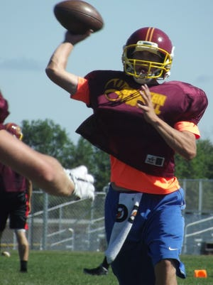 Luxemburg-Casco senior Nathan Giachino throws a screen pass during practice on Friday in Luxemburg.