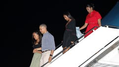 The Obama family arrives on Air Force One on Dec. 16,