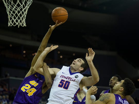 Northern Iowa's Isaiah Brown (24) and University of Evansville's Blake Simmons (50) go up for a rebound in the first half at the Ford Center on Wednesday, Jan. 31, 2018. The Purple Aces defeated the Panthers 57-49.