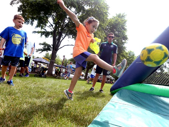 6-year-old Hailey Bastidas goes for a goal during the