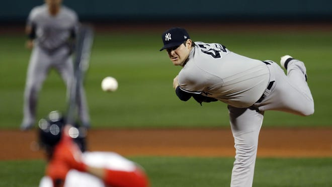 Yankees starter Jordan Montgomery fires a pitch to a Red Sox batter in the first inning on Friday night's game at Fenway Park.