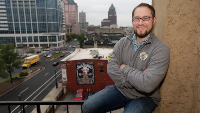 Coby Skonord, founder and CEO of Ideawake, stands on the rooftop of his office on N. Water St. in Milwaukee.