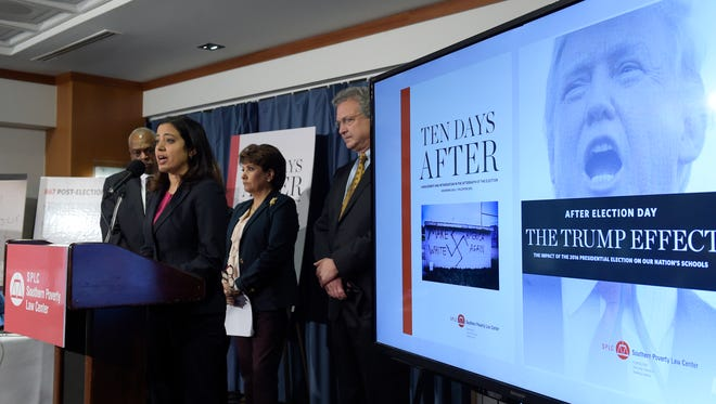 Brenda Abdelall, with Muslim Advocates, second from left, speaks during a news conference at the National Press Club in Washington, Tuesday, Nov. 29, 2016. Abdelall, standing with from left, Wade Henderson, President and CEO of The Leadership Conference on Civil and Human Rights, Janet Murguia, the President and CEO of the National Council of La Raza, and Richard Cohen, president of the Southern Poverty Law Center, called on President-elect Donald Trump to publicly denounce racism and bigotry.