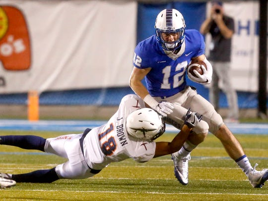 MTSU's Reed Blankenship (12) runs the ball as UTEP's