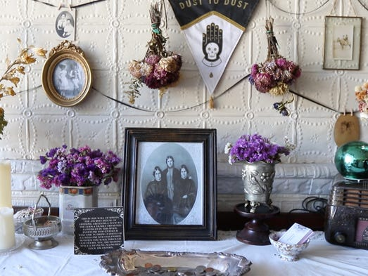 The Fox sisters photo sits near the Spirit Wall, a