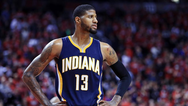 TORONTO, ON - MAY 01:  Paul George #13 of the Indiana Pacers looks on late in the second half of Game Seven of the Eastern Conference Quarterfinals against the Toronto Raptors during the 2016 NBA Playoffs at the Air Canada Centre on May 01, 2016 in Toronto, Ontario, Canada.  NOTE TO USER: User expressly acknowledges and agrees that, by downloading and or using this photograph, User is consenting to the terms and conditions of the Getty Images License Agreement.  (Photo by Vaughn Ridley/Getty Images)