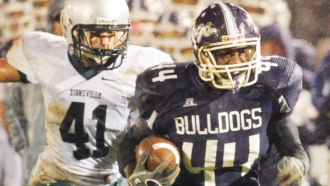 FILE -- Brownsburg RB Toks Akinribade will be a key player to watch this season.