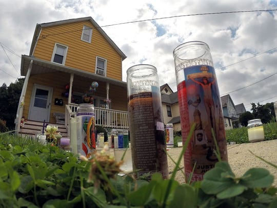 Candles line the walkway earlier this month outside a Long Branch home where a woman and her foster daughter were killed.