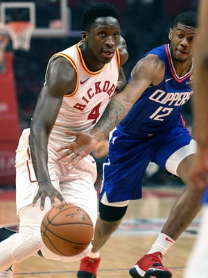 Indiana Pacers guard Victor Oladipo, left, drives against Los Angeles Clippers guard Tyrone Wallace during the first half of an NBA basketball game Sunday, April 1, 2018, in Los Angeles. The Pacers won 111-104. (AP Photo/Michael Owen Baker)
