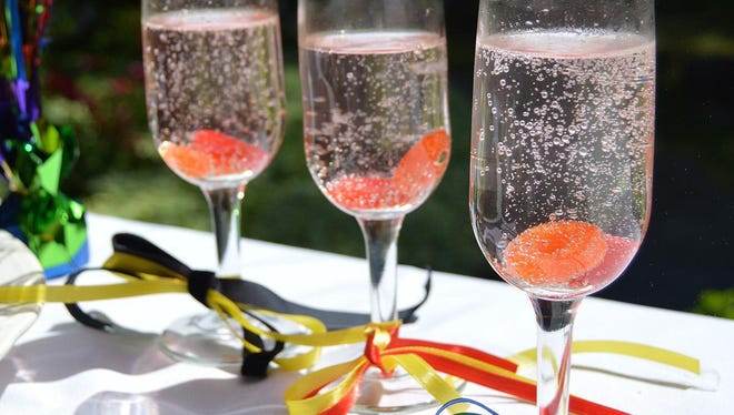 Dress up sparkling water with hard candy on the bottom.