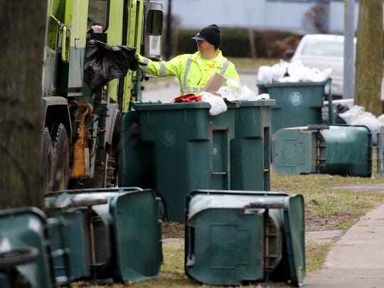 Rochester sanitation crews dealt with blown-over trash toters and lose garbage following a windstorm in April 2018.