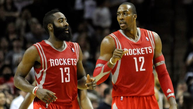 Houston Rockets guard James Harden (13) and forward Dwight Howard (12) are hoping to woo one more star to join their team.