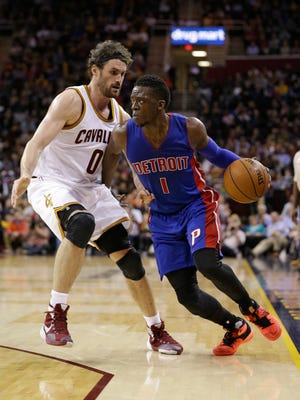Reggie Jackson drives past the Cavaliers' Kevin Love in Detroit's 96-88 victory. Jackson had 23 points.
