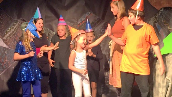 A troupe of young actors gain experience on stage.