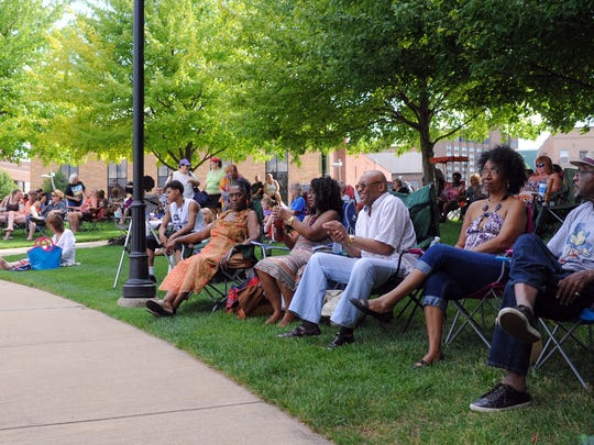 A crowd gathered in Friendship Park to listen as Tony Fields, Jeff Starr and Doug Decker performed Friday night during the Vibe @ 5 concert.