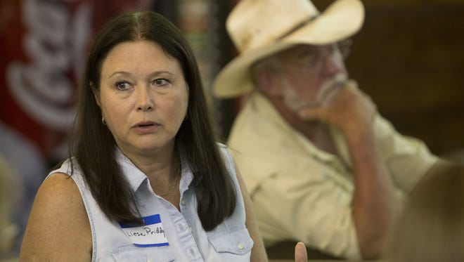 Aliesa Priddy speaks at a get together for ranchers and biologists from the National Panther Wildlife Refuge. The Florida Cabinet spent $3.75 million in 2015 to buy a conservation easement on ranch land owned by Florida Fish and Wildlife Conservation Commission member Liesa Priddy, who owns the JB Ranch near Immokalee. The Priddy family sold development rights to 1,617 acres of the 9,300-acre ranch, which sits within  prime panther habitat. The Rural and Family Lands Protection Program could be out of money by 2018.