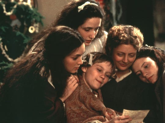 "The family gathers around the Christmas tree in a scene from the 1994 version of ""Little Women."""