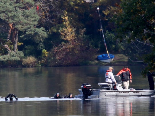 A Waukesha County Sheriff Department boat comes to the east shore of Upper Nashotah Lake with three divers during the search for a missing local sailor on Oct. 19. City of Delafield Police responded to the lake at about 1 p.m. Oct. 19 for a report of cries for help and found an overturned sailboat near the east shore in the vicinity of the Nashotah Seminary.