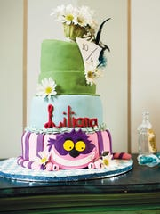The Alice in Wonderland-themed cake was designed and