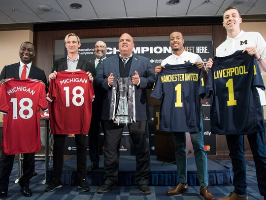 From left, Manchester United F.C. legend Andrew Cole, Liverpool F.C. legend Sami Hyypia, Charlie Stillitano, executive chairman of Relevent Sports, and Michigan basketball player Duncan Robinson, Muhammad-Ali Abdur-Rahkman pose for a photo after jersey sway during a press conference at U-M's Junge Family Champions Center in Ann Arbor, Wednesday, April 18, 2018.
