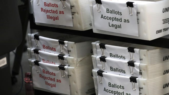 Boxes for illegal and legal vote-by-mail ballots are shown July 30 as the the Miami-Dade County canvassing board meets to verify signatures on vote-by-mail ballots for the Aug. 18 primary election at the Miami-Dade County Elections Department in Doral.