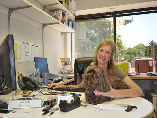 Kim Dilts and her dog, Coco.