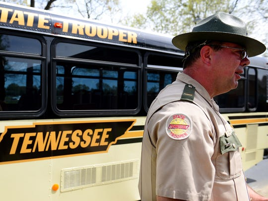 Tennessee Highway Patrol Lt. Brad Wilbanks stands in front of a Tennessee State Trooper bus to talk about about the dangers of distracted driving, Monday, April 10,. The Tennessee Highway Safety Office and Tennessee Highway Patrol partnered with local law enforcement in Jackson for Tennessee's first statewide distracted driving enforcement bus tour.
