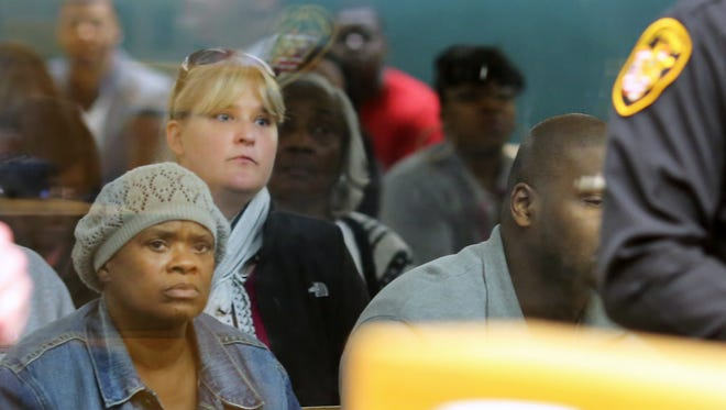 Family members of Rico Mosley and Kelsie Crow watch Mosley's arraignment.