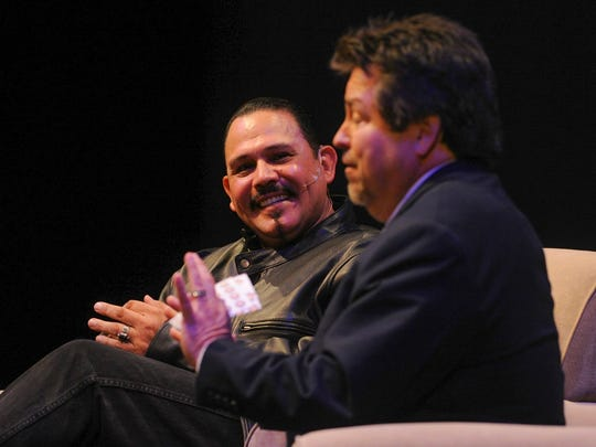 Actor Emilio Rivera, left, laughs as host Rick Najera tells a story during the Latino Thought Makers forum at Oxnard College on Wednesday evening.