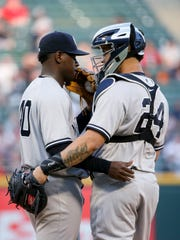 New York Yankees starting pitcher Luis Severino (40) talks with catcher Gary Sanchez (24) during the first inning against the Chicago White Sox in a baseball game Tuesday, June 27, 2017, in Chicago.