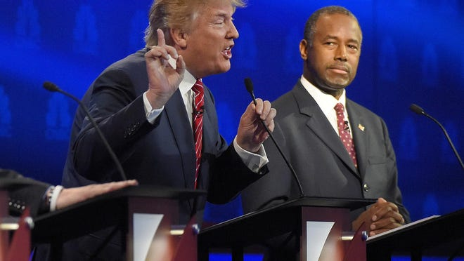 APBen Carson, right, watches as Donald Trump speaks during the CNBC Republican presidential debate at the University of Colorado on Oct. 28 in Boulder, Colo. Ben Carson, right, watches as Donald Trump speaks during the CNBC Republican presidential debate at the University of Colorado, Wednesday, Oct. 28, 2015, in Boulder, Colo. (AP Photo/Mark J. Terrill)
