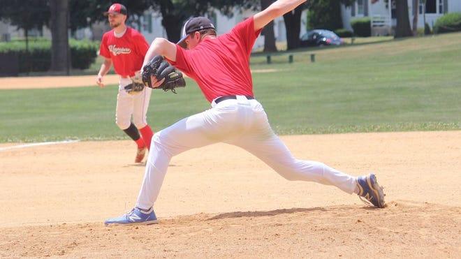 Waynesboro's Garrett Beaver goes through his side-winder delivery on the mound as third baseman Ryan McCleaf looks on, Sunday against Spring Mills.