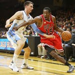 Oct 8, 2015; Boulder, CO, USA; Chicago Bulls guard Jordan Crawford (15) dribbles the ball around Denver Nuggets guard Matt Janning (12) during the second half at Coors Events Center.